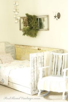 Great idea for shutters....daybed made with a old door for the back and old shutters for the arms