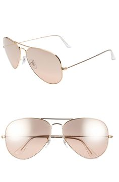 Pretty pink Ray-Ban aviators are good any time of the year.