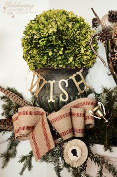 Boxwood ball with burlap bow and WISH garland