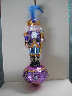 """Blown Glass Purple Nutcracker Soldier + Feather Trim Christmas Tree Ornament or decoration- 7"""" Made in Poland on Etsy, $24.89"""