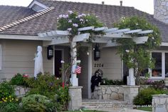 An easy-to-add front porch pergola with flowering vines. Front-Porch-Ideas-and-More.com #porch