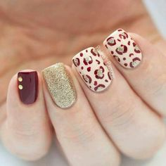 Red, white and gold winter nail art design. Fill your nails with a variety of designs such as animal prints and glitter nail art to make it stand out from the rest. You can also add golden beads on top for accent. Previous Post Next Post Cheetah Nail Designs, Leopard Print Nails, Fall Nail Designs, Leopard Prints, Red Cheetah Nails, Leopard Nail Art, Burgundy Nails, Winter Nail Art, Winter Nails