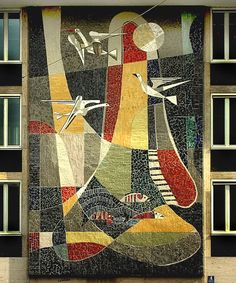 Birds-and-fish-mosaic-mural. Huge three story mid-century styled wall mosaic located in Munich; artist unknown.