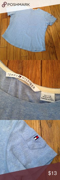 XL extra large Tommy Hilfiger blue T-shirt This size extra-large Tommy Hilfiger T-shirt is in used condition. Looks great on. Has a super tiny stain on the bottom left part of the shirt. This is pointed out in the photos. Absolutely loved The shirt! Please see photos. Please ask any questions before purchasing. Note that photos also have measurements. Tommy Hilfiger Tops Tees - Short Sleeve