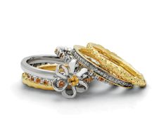 Pair Citrine and Gold bands for a bold pop of yellow    http://stackableexpressions.com/pl/Gemstone-Rings-Citrine