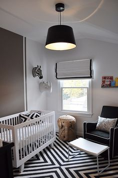 Forget greens and yellows, go for black/white if you're waiting to find out the baby's gender!