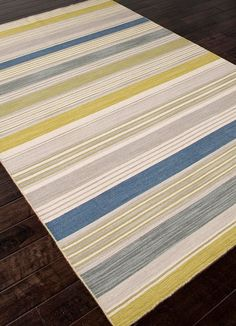 Love the dash of lime green with driftwood gray and denim blue!  For a fresh look for summer, you cant beat a new rug - http://caronsbeachhouse.com/coastal-area-rugs/coastal-hand-woven-flatweave-rugs/cielo-blue-lime-and-gray-striped-dhurrie-area-rug.html