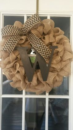 This adorable 18inch hand made wreath with a painted wooden initial and burlap bow is perfect for your front door all year round. The wreath is made