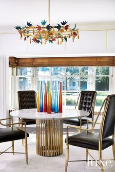 Eclectic White Dining Room with 1950s Chandelier