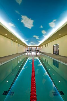 Modern Indoor Pools-45-1 Kindesign. This Olympic sizes pool is a perfect training facility. It uses Geo-thermal to heat the pool and building. The flat roof is topped with a tennis court.