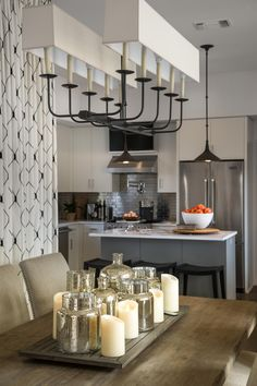 Beautiful Silver and candles dinning center piece. - Dining Room Pictures From HGTV Smart Home 2015 | HGTV