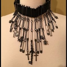 Black Safety Pin Choker Adjustable Snap.  Plenty of Safety Pins, Chains, Crosses and Skulls on this Choker!  Some might wear it anytime, others as an accessory for a Halloween Costume. Jewelry Necklaces