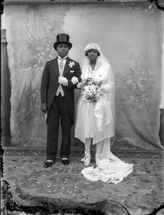 Bride and groom, c. 1920's. Amazing photo, beautiful attire and great to see the backdrop.