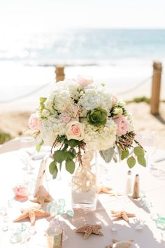 starfish and seashell accented wedding table for your beach wedding reception #beach #weddingdecor #centerpiece @weddingchicks