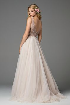 This ball gown features a skirt of Soft Netting and Tulle with an exquisitely beaded Colette Lace bodice, creating a dreamy silhouette the elegant, yet modern bride will love. Sweep train. Spring 2017 PLEASE NOTE THIS IS A NEW GOWN FROM THE DESIGNER AND TAKES 3 MONTHS TO SHIP Please contact a consultant to discuss sizing or rush shipping