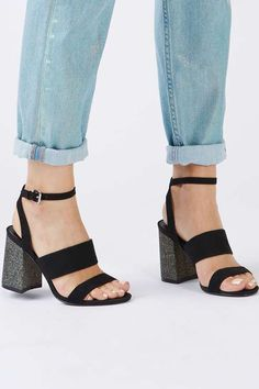 We can't decide what we love more – the multi strap detail or the glitter block heel of these cool sandals. Pair with rolled-at-the-hem jeans for a pared down look or a velvet dress for a party-ready finish. #Topshop