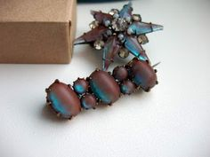 two saphiret brooches