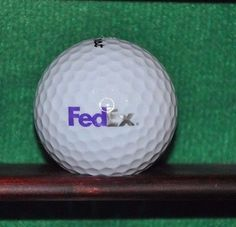 Fed Ex Corporation logo golf ball. Titleist