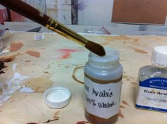 Great tip: Use Gum Arabic cut with water to reshape/re-point paint brushes.