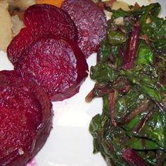 "Roasted Beets and Sauteed Beet Greens | ""Yum, yum, yum! This was so good! I've never cooked beets before and I'm so glad I picked this recipe for my first time. Hubby and I both really enjoyed this dish. I tried the red wine vinegar on some and butter/S on some and enjoyed both, but I think I like the butter/S best. Will definitely make again, thanks for sharing!"" http://allrecipes.com/recipe/roasted-beets-and-sauteed-beet-greens/Detail.aspx"