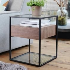 The clear glass top floats above the drawer unit offering extra space below leaving the table top clear for lamps, clocks or that well-deserved glass of wine. The base of this neat side table is also glass to both counterbalance the design and offer further storage that side tables don't often offer.