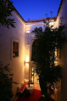 The large central courtyard is open to the night sky and brings in fresh air in Le Nid, a luxury hotel in the heart of the medina. Marrakech, Morocco