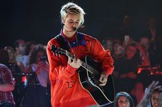Justin with his guitar is my fav