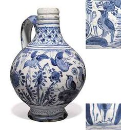 A LONDON DELFT DATED BLUE AND WHITE CHINOISERIE WINE-BOTTLE 1628, SOUTHWARK, PICKLEHERRING QUAY Of conventional form, painted with a frieze of 'birds-on-rocks' amongst flowering plants and an insect, the neck with a trellis-pattern band, indistinctly dated 1628 below the handle