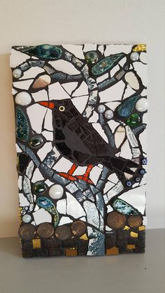 mosaic blackbird on tree