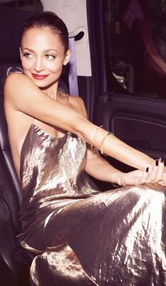 Nicole Richie works the '90s look in a metallic Marc Jacobs slip dress.