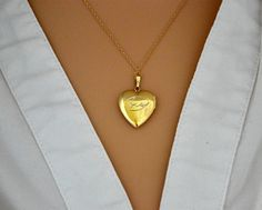 Check out this item in my Etsy shop https://www.etsy.com/listing/268371873/heart-locketgold-picture-locketgold