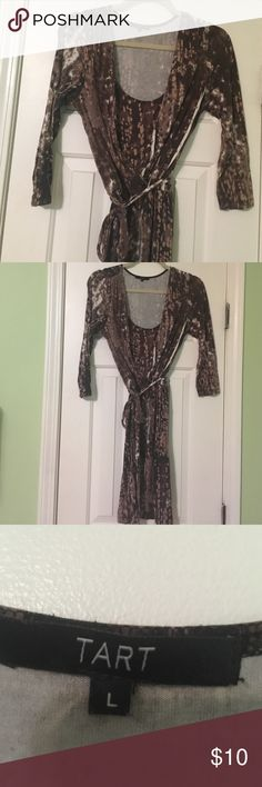 Brown Tart Faux Wrap Dress Large Super flattering dress. It has a brown and white pattern. The fabric is very soft. I recommend hand washing to prevent pilling. Great for work! Tart Dresses Long Sleeve