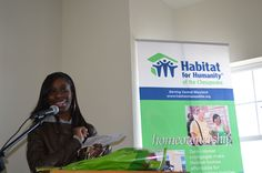 New homeowner Shatia offers remarks at dedication of six homes in Orchard Ridge community.