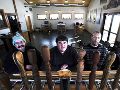 Co-brewers Jason Peterson and Matt Nissen and owner Elliot Thompson pose at their new Alluvial Brewery on West 190th Street north of Ames. Photo by Nirmalendu Majumdar/Ames Tribune