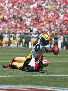 Randall Cobb of the Green Bay Packers stretches across the goal line for a  touchdown in the first quarter during an NFL game against San. c8f9778c196c