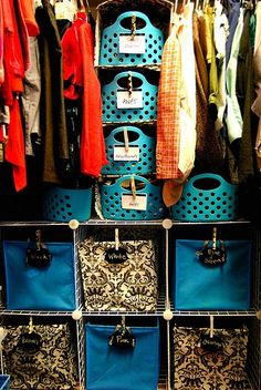 """Closet organization; Don't really like the color-coated bins or the baskets down the middle, but could totally implement this to work differently. Could use the bottom bins for other things, such as """"Shorts, Jean Shorts, Pants, Jeans, Skirts, Pajama Pants"""". As for the middle baskets, use those for things like scarves, belts, socks, etc."""