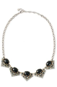 Add sparkle in this art deco necklace with black or blue stones hanging from a vintage gold chain. The Rory Necklace from Stella & Dot is the perfect touch.