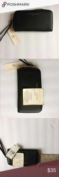 Adrienne Vittadini Charging Wallet Beautiful smooth black zip around charging phone wallet. NWT Adrienne Vittadini Bags Wallets