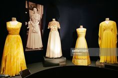 Dresses by designers Sir Norman Hartnell, Sir Hardy Amies and Ian Thomas stand on display at an exhibition of Queen Elizabeth II's dresses, for the summer opening of the State Rooms of Buckingham Palace on July 2006 in London, England. Princess Elizabeth, Princess Margaret, Queen Elizabeth Ii, Royal Dresses, Prom Dresses, Norman Hartnell, Hardy Amies, Elisabeth Ii, Royal Fashion