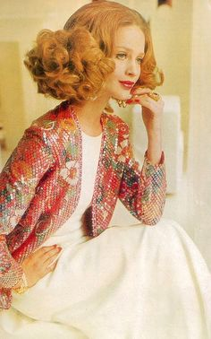 Celia Hammond is wearing long white jersey column topped with colorful sequined cardigan by Susan Small, photo by Henry Clarke, Vogue 1968