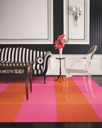 Acrylic 'ghost' chair, traditional sofa with stripes & a colorful rug. But cut the pink. Definite allergy to pink. Traditional Sofa, Orange Rugs, Orange Carpet, Pink Carpet, Painted Floors, Carpet Tiles, Dream Decor, Pink And Green, Orange Pink