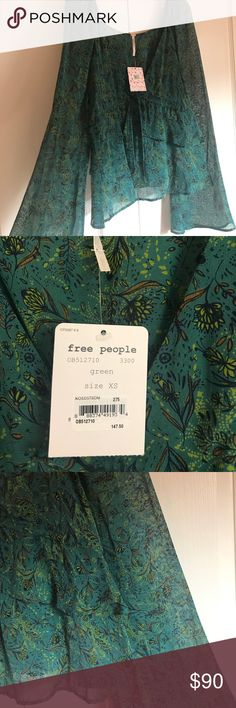 Free People floral blouse Pretty emerald green floral top with bell sleeves and tiered chiffon. Ties across middle to tighten or loosen. Brand new with tags. Free People Tops Blouses