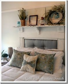 Fireplace mantel used as a headboard.  Would love to do this!