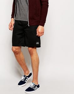 "Shorts by Jack & Jones Soft-touch quilted sweat Drawstring waistband Logo patch detail Side pockets Loose fit - falls loosely over the body Machine wash 100% Polyester Our model wears a size Medium and is 185.5cm/6'1"" tall"