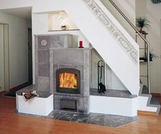 Beautiful Design of Storage under Stairs; Maximize Your Unused Space with Function : Fireplace Under Stairs Storage In Living Room Living Room Under Stairs, Space Under Stairs, Living Room With Fireplace, Gas Fireplace, Open Stairs, Modern Fireplace, Electric Fireplace, Stair Shelves, Staircase Storage