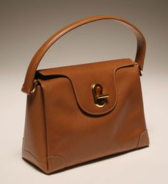 Vintage Gucci G clasp tan leather   I've had this bag in navy, black, and red. Still looking for tan !!  Reminds me of Aigner oxblood kelly bag of Junior High Days