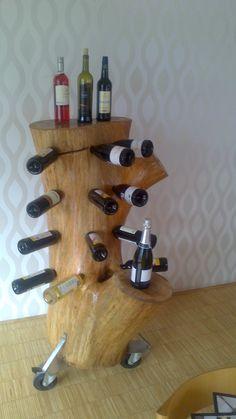 Een ouden eik krijgt een nieuw leven als wijnrek.