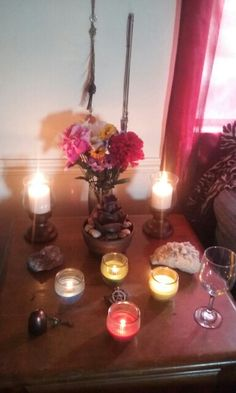 My Beltane Altar with my new stone fountain in front of my flowers. Small but I loved it!