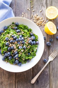 This Kale and Blueberry Salad with Sunflower Seeds and Honey Lemon Vinaigrette #healthy #kale #salad