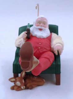 1999 Coca Cola Santa Claus Kicking Off Boots w/ Baby Reindeer Christmas Ornament #CocaCola